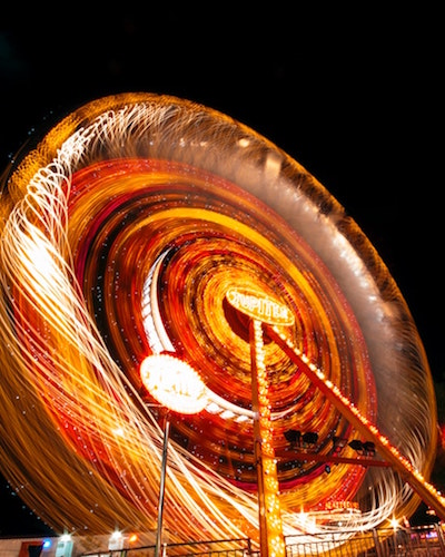 Spinning Lighted Ferris Wheel – analogy of chakra energy vortex (image by Engin Akyurt, Pexels.com) © Wicca-Spirituality.com